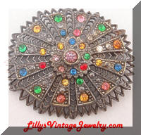 LN 25 multi colored rhinestones vintage brooch