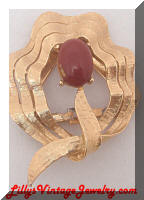 Golden red-ish brown cab dress clip brooch